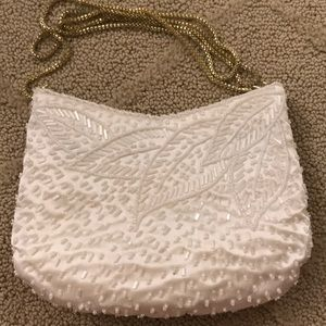 La Regale vintage ivory beaded clutch with chain